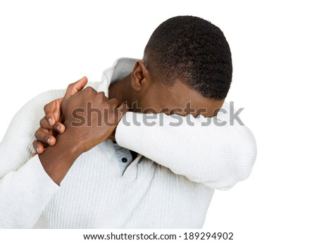 Closeup portrait, very sad depressed, stressed, alone, disappointed gloomy young man, hand hiding under arm, having suicidal thoughts, isolated white background. Human emotion facial expression - stock photo