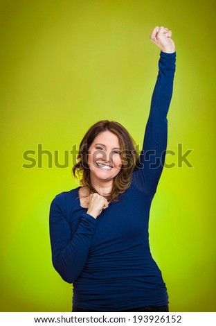 Closeup portrait winning successful young business woman happy ecstatic celebrating being winner isolated green background. Positive human emotion facial expression, attitude Life achievement concept - stock photo