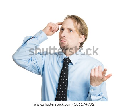 Closeup portrait young business man thinking, daydreaming, trying hard to remember something looking confused, isolated white background. Negative emotion facial expressions. Short-term memory loss - stock photo