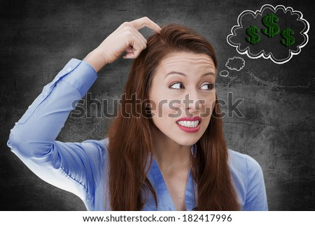 Closeup portrait young business woman scratching head, thinking deeply how to make money looking sideways isolated black background bubble filled with dollar signs. Facial expression, emotion, feeling - stock photo