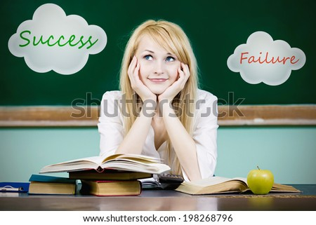 Closeup portrait young business woman, student sitting at desk in classroom, thinking, success, failure choice, looking up isolated chalkboard background. Human facial expressions, life perception - stock photo