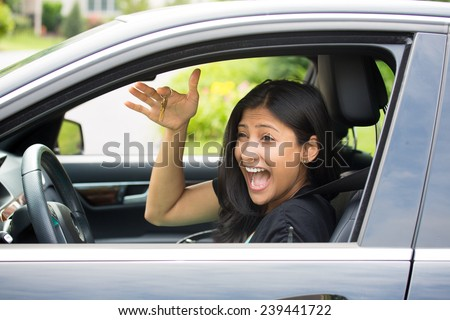 Closeup portrait, young cheerful, joyful, smiling, gorgeous woman holding up keys to her first new car. Super funny excitement. Customer satisfaction - stock photo