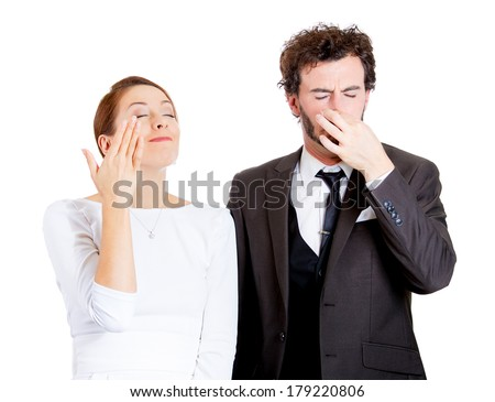 Closeup portrait young couple, man, woman. Female happy smiling, enjoying aroma, male unhappy pinching his nose, disgust on face, hates the smell, isolated on white background. Perception contrast - stock photo