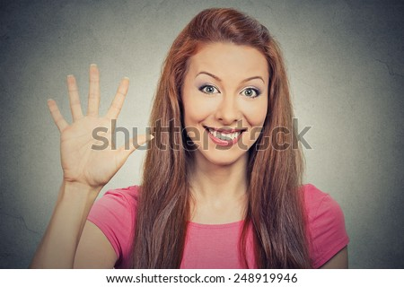 Closeup portrait, young excited woman, making five times sign gesture with hand fingers, isolated grey wall background. Positive human emotion facial expression feeling, attitude, symbol body language - stock photo