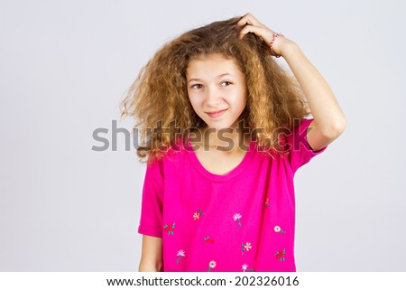 Closeup portrait young girl scratching head, thinking daydreaming deeply about something, looking up, isolated grey background. Human facial expressions, emotions, feeling, sign, symbol, body language - stock photo