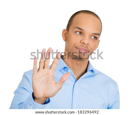 Closeup portrait young, handsome, grumpy man with bad attitude giving talk to hand gesture with palm outward, isolated white background. Negative emotions, facial expression feelings, body language - stock photo