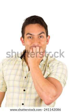 closeup portrait young handsome hispanic man biting nails nervous isolated on white