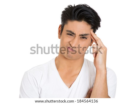 Closeup portrait, young man scratching head, thinking, daydreaming, trying to come up with solution for the problem, isolated white background. Human facial expressions, emotions, signs symbols - stock photo