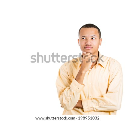 Closeup portrait young man thinking, daydreaming deeply about something with hand on chin looking upwards, isolated white background, copy space to left. Human facial expression signs, life perception - stock photo