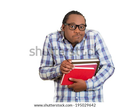 Closeup portrait young nerdy, funny, crazy looking man with glasses, timid, shy, anxious, nervous, student holding books, skeptical uncertain isolated white background. Human emotion facial expression - stock photo