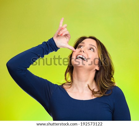 Closeup portrait young, silly, goofy woman, gesturing with hand thumb to go party, get drunk, hammered, wasted, isolated green background. Positive emotions, facial expressions, feeling, sign, symbol - stock photo