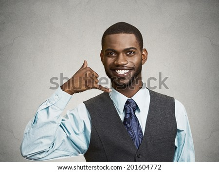 Closeup portrait young single business man, handsome happy guy, worker making call me gesture sign with hand shaped like phone, isolated black grey background. Positive human emotions face expressions - stock photo