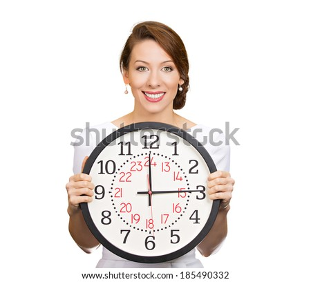 Closeup portrait young smiling business woman, successful happy executive, banker, employee holding wall clock, isolated white background, clipping path. Human, positive face expressions, emotion. - stock photo