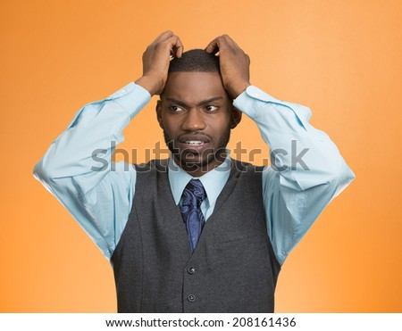 Closeup portrait, young, stressed, unhappy executive man with hands on temples, head about to explode, almost having nuclear meltdown, isolated orange color background. Warhol style picture - stock photo