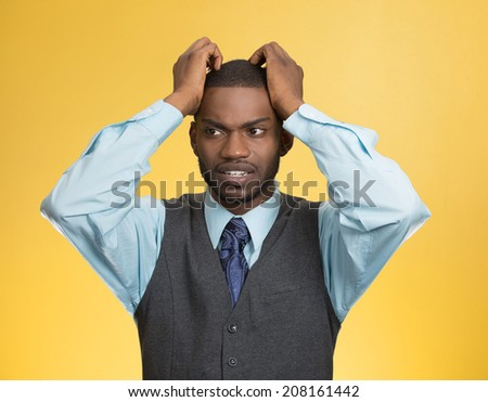 Closeup portrait, young, stressed, unhappy executive man with hands on temples, head about to explode, almost having nuclear meltdown, isolated yellow color background. Warhol style picture - stock photo