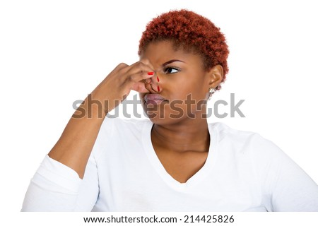 Closeup portrait young woman, disgust on face, pinches nose, something stinks, very bad smell, situation, isolated white background. Negative human emotions, facial expressions, feelings, reaction - stock photo