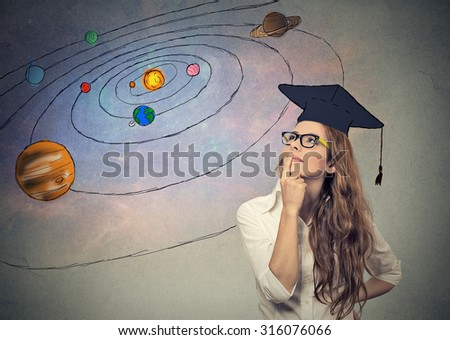 Closeup portrait young woman student dreaming, thinking about future, life on other planets, isolated on gray space background with stars planets - stock photo