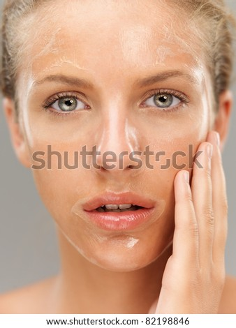 closeup portrait young woman with facial mask - stock photo