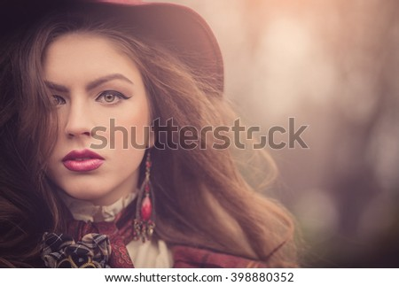 Closeup portraits of a beautiful Jewish girl in a pink hat in a retro style with a professional makeup and bright lipstick, emotions, vintage