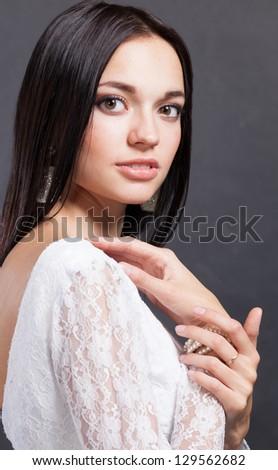 Closeup portret of a young beautiful woman. - stock photo