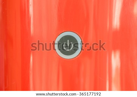 Closeup power button at red coffee machine background - stock photo