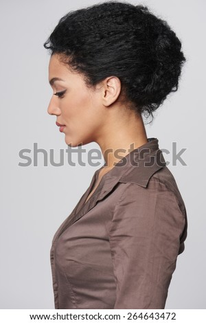 Closeup profile portrait of beautiful african american business woman - stock photo