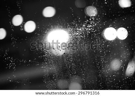 closeup  raindrops on the window. black and white picture - stock photo