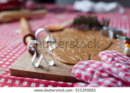 Closeup raw dough for gingerbread cookies for Christmas at home kitchen - stock photo