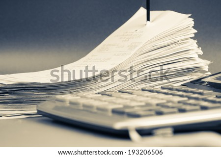 Closeup receipts in paper nail - stock photo