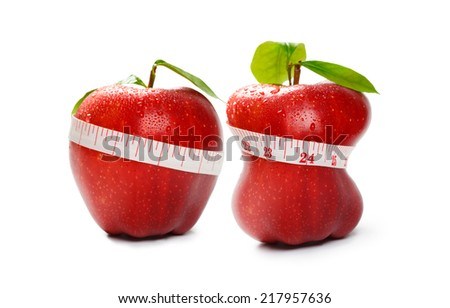 Closeup red apple with tapeline isolated over white, Diet or weight loss concept - stock photo