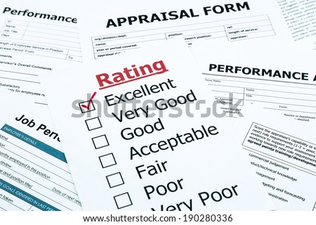 closeup red excellent check mark on rating form, evaluation and assessment concept for human resource and business - stock photo