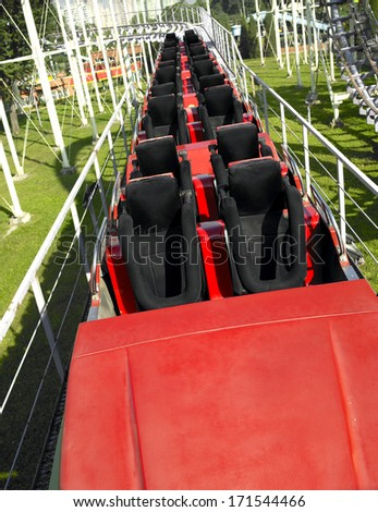 Closeup roller coaster,In the amusement park - stock photo