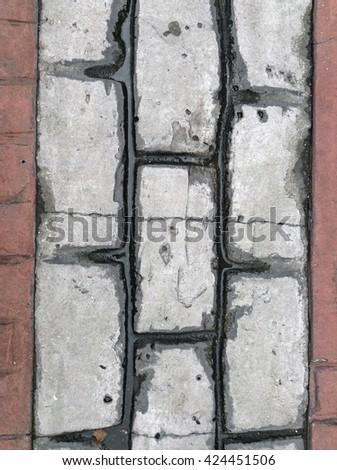 Closeup rough brick block or concrete road - stock photo