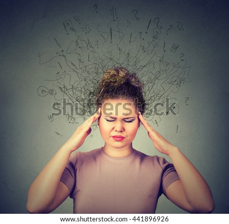 Closeup sad young woman with worried stressed face expression and brain melting into lines question marks. Obsessive compulsive, adhd, anxiety disorders concept  - stock photo