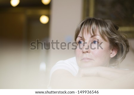 Closeup selective focus of a pensive middle aged woman - stock photo