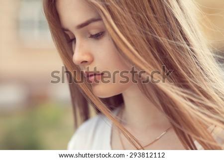 Closeup sensual portrait of beautiful girl outdoors - stock photo