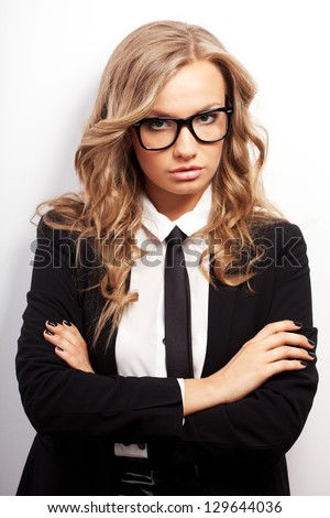 closeup seriously blonde businesswoman portrait wearing eyeglasses - stock photo