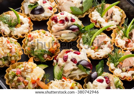closeup set different canapes and snacks in plastic black form for mobile catering - stock photo