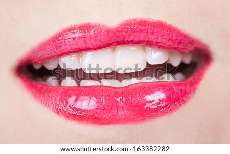 Closeup Shoot of Beautiful Lips of Woman with Red Lipstick and Gloss.  - stock photo