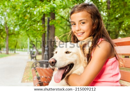 Closeup shoot of girl with her dog - stock photo