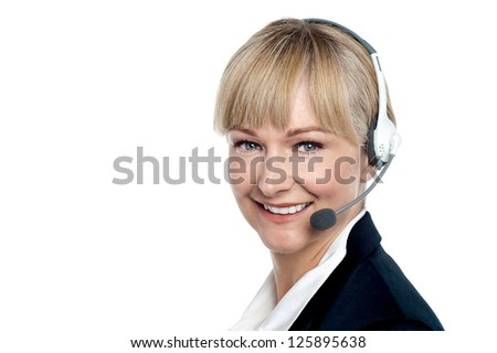 Closeup shot of a cheerful executive assisting customer over a call.