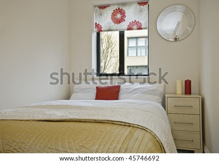 closeup shot of a double bed with bedside table and decoration - stock photo