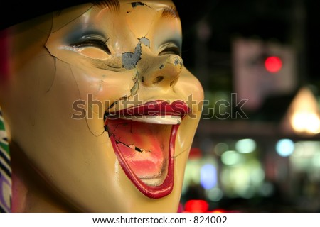 Closeup shot of a laughing broken mannequin face.