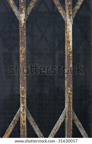closeup shot of a rusty fence bars - stock photo