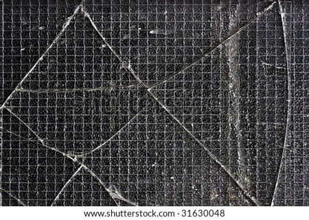 closeup shot of a shattered glass window - stock photo