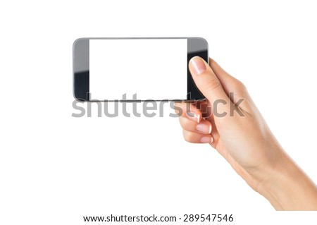 Closeup shot of a woman showing modern mobile phone isolated on white background. Girl holding a smartphone with white screen in horizontal. Young woman's hand showing an horizontal cellphone. - stock photo