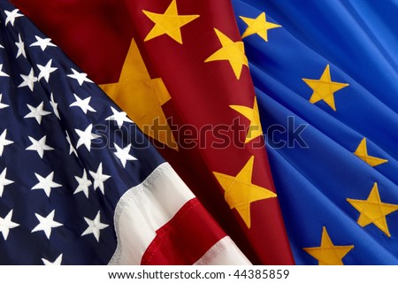 Closeup shot of American, Chinese and European Union flags - stock photo