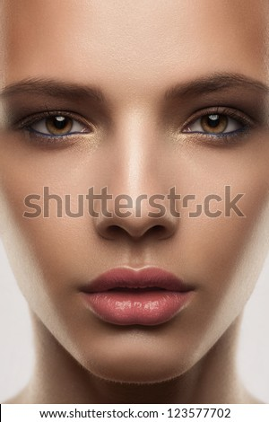 Closeup shot of attractive young woman with stylish makeup - stock photo