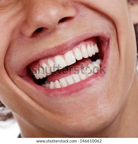 Closeup shot of awesome healthy teeth over white background - stock photo