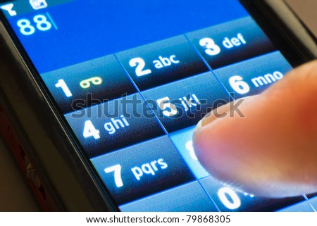 closeup shot of dialing on touxh screen smartphone